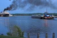 2012-05-16-0054 Tug and Barge Spartan Passes Docked Badger